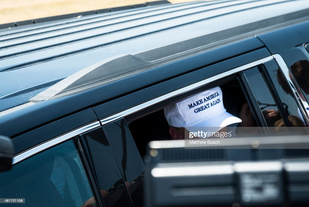 Republican Presidential candidate and business mogul Donald Trump exits his car wearing a 'Make America Great Again' hat during his trip to the...