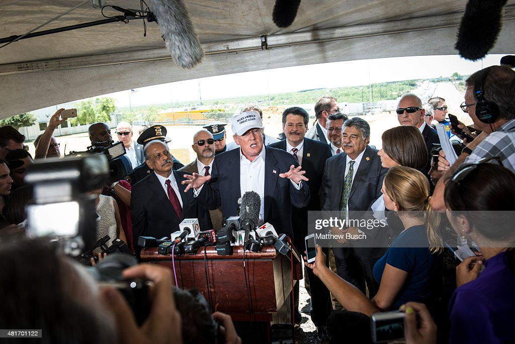 Republican Presidential candidate and business mogul Donald Trump talks to the media along the US Mexico border during his trip to the border on July...