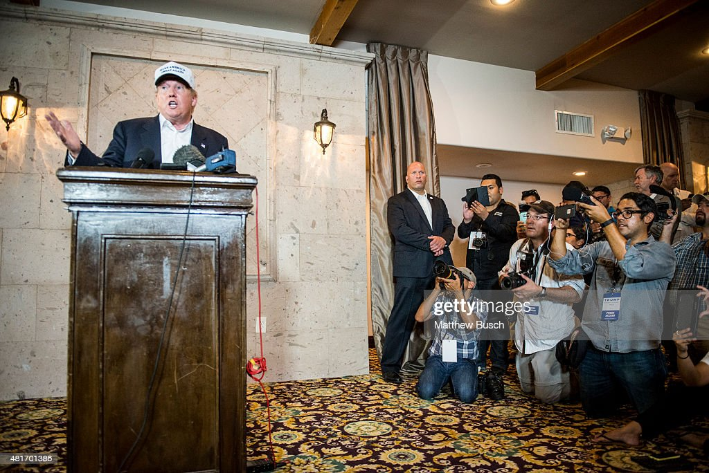 Republican Presidential candidate and business mogul Donald Trump talks to the media at a press conference during his trip to the border on July 23...