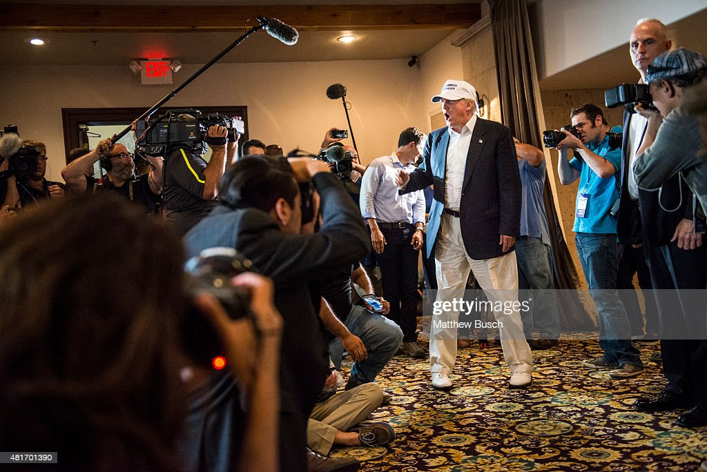 Republican Presidential candidate and business mogul Donald Trump talks to the media before a press conference during his trip to the border on July...