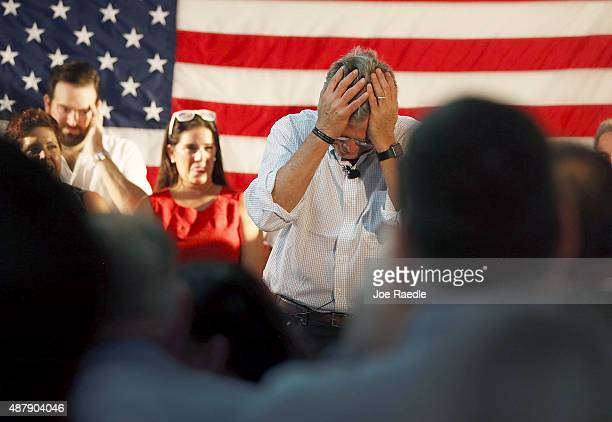 Republican presidential candidate and former Florida Governor Jeb Bush holds his head after making a comment about fellow Republican primary...