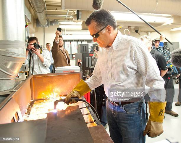 Republican presidential candidate and former MA Governor Mitt Romney cutting his initials out of a piece of steel at Hypertherm in Hanover NH on...