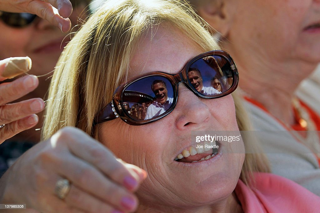 Republican presidential candidate and former Massachusetts Gov. Mitt Romney is reflected in the sunglasses of a supporter as he greets people during a rally with supporters at Pioneer Park on January 30, 2012 in Dunedin, Florida. Romney is campaigning across the state ahead of the January 31 Florida primary.