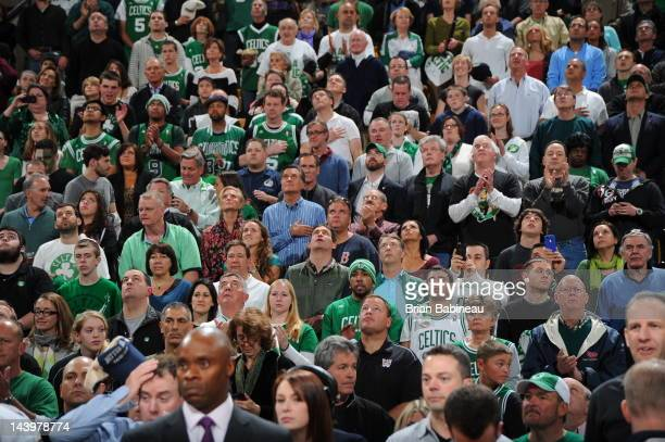 Republican presidential candidate and former Massachusetts Gov Mitt Romney and wife Ann are seen during National Anthem in attendance for the game...