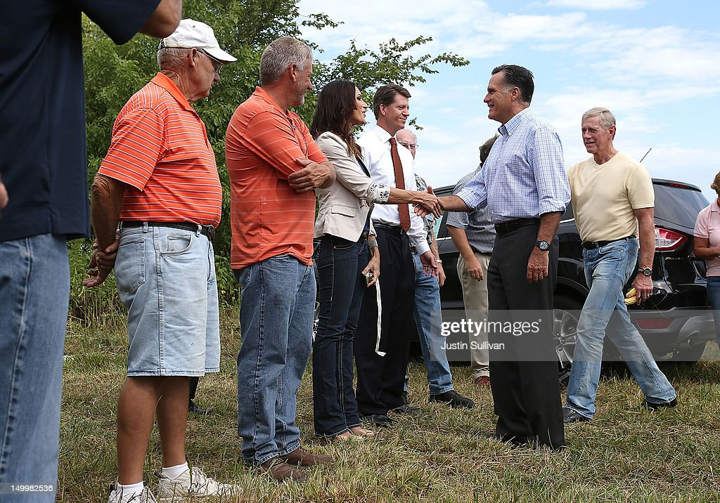 Republican presidential candidate and former Massachusetts Gov. <a gi-track='captionPersonalityLinkClicked' href=/galleries/search?phrase=Mitt+Romney&family=editorial&specificpeople=207106 ng-click='$event.stopPropagation()'>Mitt Romney</a> (R) greets supporters after touring the corn farm of Lemar Koethe on August 8, 2012 in Des Moines, Iowa. <a gi-track='captionPersonalityLinkClicked' href=/galleries/search?phrase=Mitt+Romney&family=editorial&specificpeople=207106 ng-click='$event.stopPropagation()'>Mitt Romney</a> is campaigning in Iowa before traveling to New Jersey and New York for fundraising events.