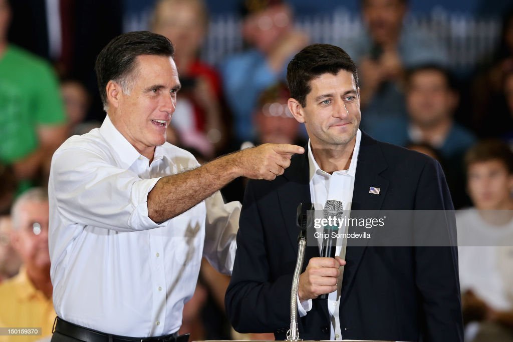 Republican presidential candidate and former Massachusetts Gov. <a gi-track='captionPersonalityLinkClicked' href=/galleries/search?phrase=Mitt+Romney&family=editorial&specificpeople=207106 ng-click='$event.stopPropagation()'>Mitt Romney</a> (L) and his vice presidential running mate Rep. Paul Ryan (R-WI) take the stage during a campaign event at the Crenshaw Gymnasium on the campus of Randolph-Macon College August 11, 2012 in Ashland, Virginia. The chairman of the House Budget Committee, Ryan, 42, has been a member of Congress from Wisconsin since 1999 and has earned praise from the right for his conservative fiscal positions.