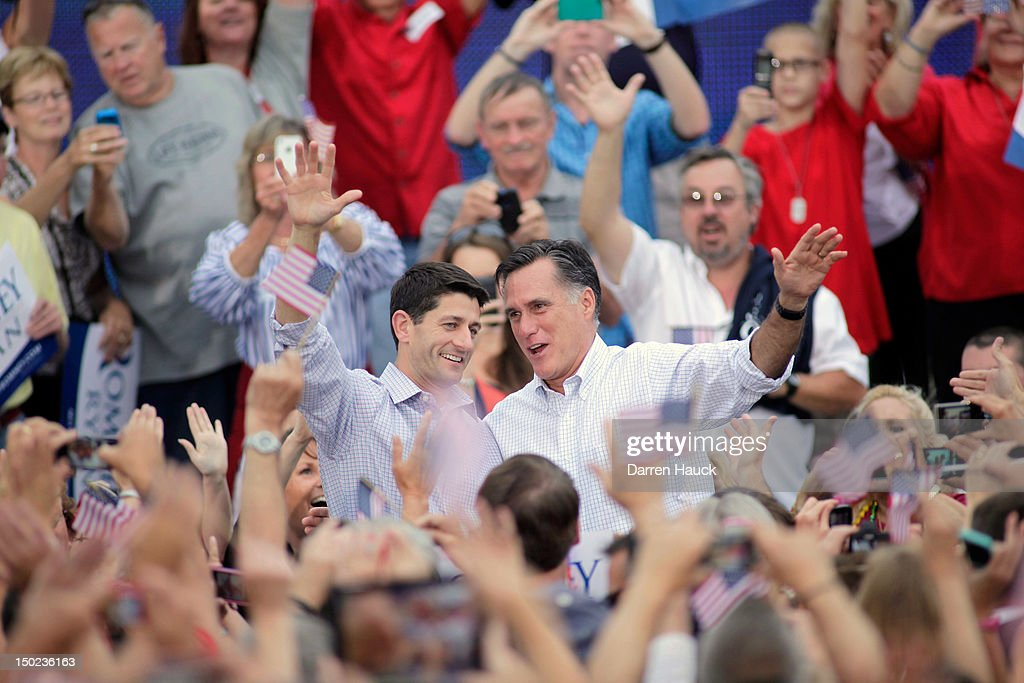 Republican presidential candidate and former Massachusetts Gov. Mitt Romney and vice presidential candidate and Wisconsin native Rep. Paul Ryan (R-WI) (L) greet supporters during a campaign event at the Waukesha Expo Center on August 12, 2012 in Waukesha, Wisconsin. Romney continues his four day bus tour a day after announcing his running mate, Rep. Paul Ryan.
