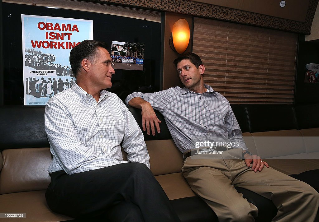 Republican presidential candidate and former Massachusetts Governor Mitt Romney (L) and his running mate Rep. Paul Ryan (R-WI) talk on their campaign bus before attending a campaign rally at the Waukesha County Expo Center on August 12, 2012 in Waukesha, Wisconsin. Mitt Romney continues his four day bus tour a day after announcing his running mate, Rep. Paul Ryan (R-WI).