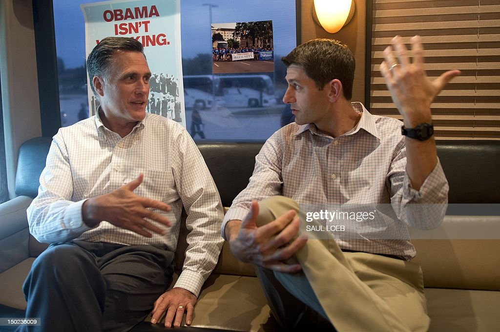 US Republican presidential candidate and former Massachusetts Governor Mitt Romney (L) and vice presidential hopeful Wisconsin Representative Paul Ryan talk on their campaign bus prior to a campaign rally at Waukesha County Expo Center in Waukesha, Wisconsin, August 12, 2012. Romney and Ryan visit Ryan's home state on the second day of a 4-day bus trip that will take Romney to 4 key swing states, Virginia, North Carolina, Florida and Ohio. AFP PHOTO / Saul LOEB