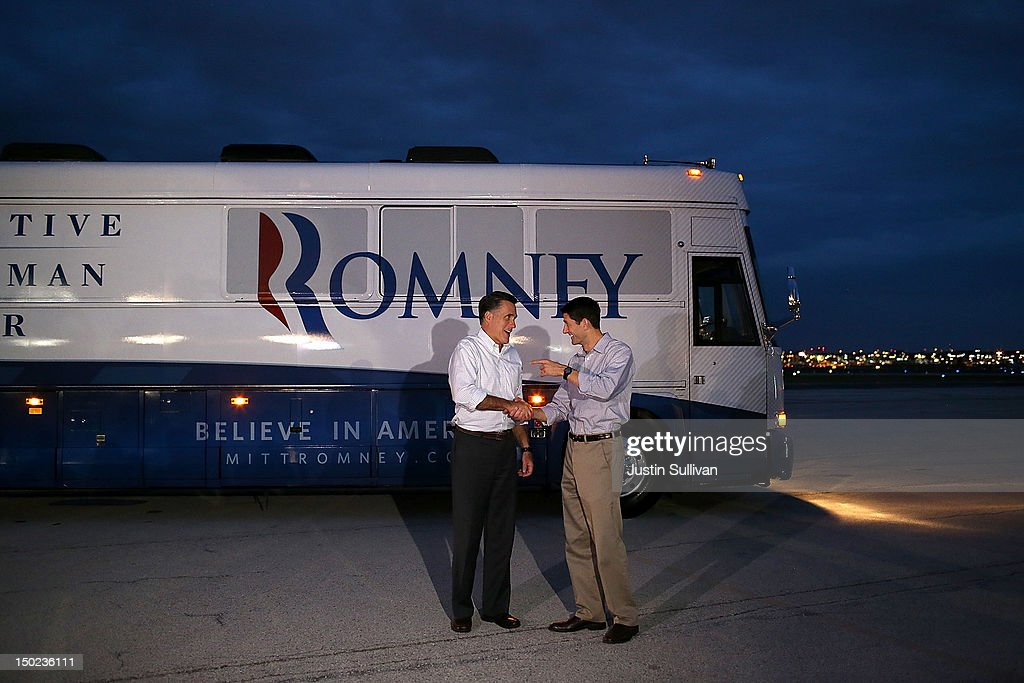 Republican presidential candidate and former Massachusetts Governor Mitt Romney (L) shakes hands with his running mate Rep. Paul Ryan (R-WI) before parting ways on the tarmac after at Milwaukee-Mitchell Airport on August 12, 2012 in Milwaukee, Wisconsin. After two days of campaigning together, Mitt Romney and his running mate Paul Ryan will go separate ways to campaign individually.