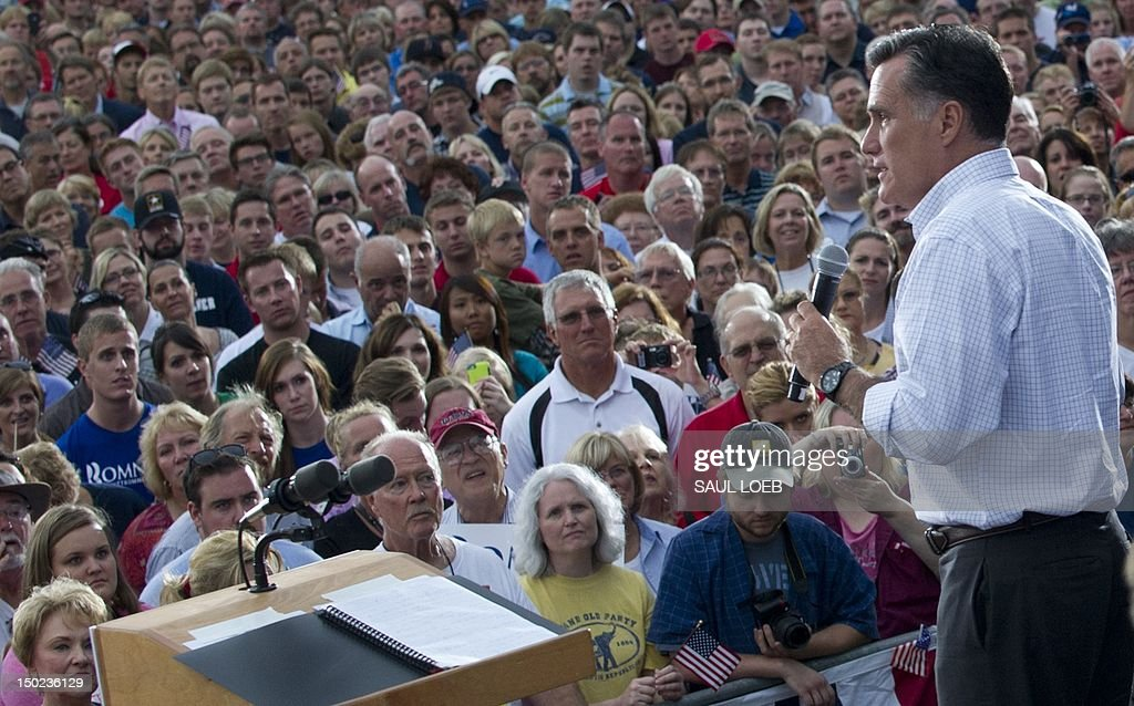 US Republican presidential candidate and former Massachusetts Governor Mitt Romney speaks during a campaign rally at Waukesha County Expo Center in Waukesha, Wisconsin, August 12, 2012. Romney and Ryan visit Ryan's home state on the second day of a 4-day bus trip that will take Romney to 4 key swing states, Virginia, North Carolina, Florida and Ohio. AFP PHOTO / Saul LOEB