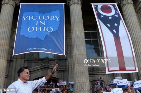 Republican presidential candidate and former Massachusetts Governor Mitt Romney greets supporters during a campaign rally at Ross County Courthouse...