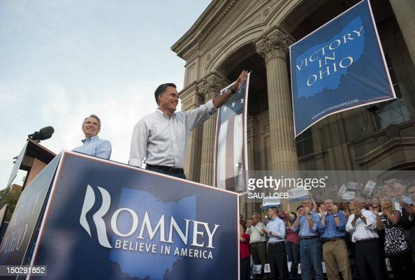 US Republican presidential candidate and former Massachusetts Governor Mitt Romney waves alongside Ohio Republican Senator Rob Portman during a...