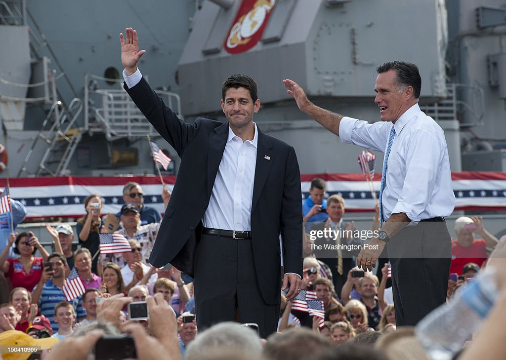 Republican presidential candidate and former Massachusetts Governor Mitt Romney, right, and vice presidential candidate U.S. Rep. Paul Ryan, wave to supporters after a campaign speech at the Nauticus Museum while campaigning on August 11, 2012 in Norfolk, Va. The former governor announced his running mate before the start of a four-day bus tour that starts in Virginia and travels to Florida, North Carolina and Ohio.