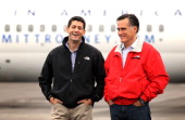 Republican presidential candidate and former Massachusetts Governor Mitt Romney and his running mate US Rep Paul Ryan listen during a campaign rally...