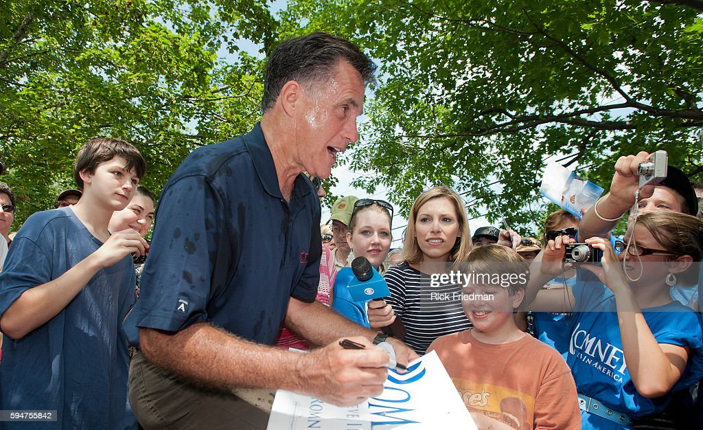 Republican presidential candidate and former Massachusetts Governor MItt Romney marching in the Amherst New Hampshire July 4th Independence Day...