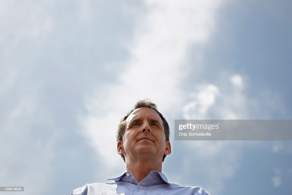 Republican presidential candidate and former Minnesota Governor Tim Pawlenty talks to voters at the Des Moines Register's Soapbox during the second day of the Iowa State Fair August 12, 2011 in Des Moines, Iowa. All of the Republican presidential hopefuls are visiting the fair ahead of Saturday's Iowa Straw Poll to greet voters and engage in traditional Iowa campaigning rituals.