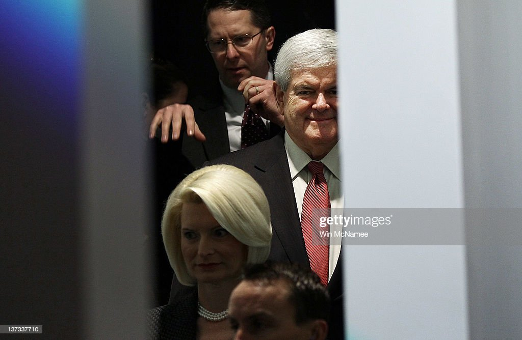 Republican presidential candidate and former Speaker of the House <a gi-track='captionPersonalityLinkClicked' href=/galleries/search?phrase=Newt+Gingrich&family=editorial&specificpeople=202915 ng-click='$event.stopPropagation()'>Newt Gingrich</a> (R) and his wife <a gi-track='captionPersonalityLinkClicked' href=/galleries/search?phrase=Callista+Gingrich&family=editorial&specificpeople=4374496 ng-click='$event.stopPropagation()'>Callista Gingrich</a> (L) wait back stage while being introduced for a Town Hall meeting at Sun City's Magnolia Hall January 19, 2012 in Bluffton, South Carolina. Texas Gov. Rick Perry is expected to announce this morning that he is withdrawing from the race for the Republican nomination prior to the South Carolina primary and support Gingrich.