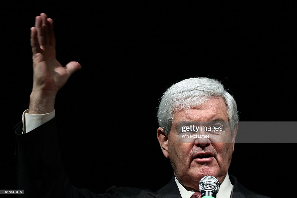 Republican presidential candidate and former Speaker of the House <a gi-track='captionPersonalityLinkClicked' href=/galleries/search?phrase=Newt+Gingrich&family=editorial&specificpeople=202915 ng-click='$event.stopPropagation()'>Newt Gingrich</a> answers questions during a Town Hall meeting at Sun City's Magnolia Hall January 19, 2012 in Bluffton, South Carolina. Texas Gov. Rick Perry is expected to announce this morning that he is withdrawing from the race for the Republican nomination prior to the South Carolina primary and endorsing Gingrich.