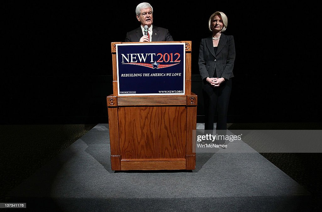 Republican presidential candidate and former Speaker of the House <a gi-track='captionPersonalityLinkClicked' href=/galleries/search?phrase=Newt+Gingrich&family=editorial&specificpeople=202915 ng-click='$event.stopPropagation()'>Newt Gingrich</a> (L) speaks during a Town Hall meeting as his wife <a gi-track='captionPersonalityLinkClicked' href=/galleries/search?phrase=Callista+Gingrich&family=editorial&specificpeople=4374496 ng-click='$event.stopPropagation()'>Callista Gingrich</a> listens at Sun City's Magnolia Hall January 19, 2012 in Bluffton, South Carolina. Texas Gov. Rick Perry is expected to announce this morning that he is withdrawing from the race for the Republican nomination prior to the South Carolina primary and support Gingrich.