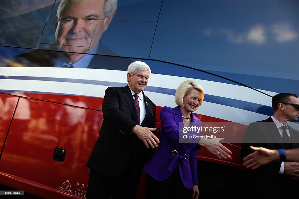 Republican presidential candidate and former Speaker of the House <a gi-track='captionPersonalityLinkClicked' href=/galleries/search?phrase=Newt+Gingrich&family=editorial&specificpeople=202915 ng-click='$event.stopPropagation()'>Newt Gingrich</a> (L) and his wife <a gi-track='captionPersonalityLinkClicked' href=/galleries/search?phrase=Callista+Gingrich&family=editorial&specificpeople=4374496 ng-click='$event.stopPropagation()'>Callista Gingrich</a> (2L) greet supporters and pose for photographs outside a polling place on primary day January 31, 2012 in Celebration, Florida. Polls show Gingrich's fellow candidate, former Massachusetts Gov. Mitt Romney, with a double-digit lead going into the Florida primary.