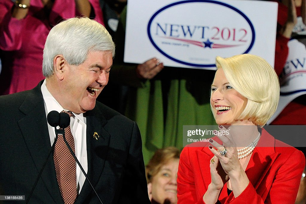 Republican presidential candidate and former Speaker of the House Newt Gingrich (L) and his wife Callista Gingrich laugh during a campaign rally at Stoney's Rockin' Country February 3, 2012 in Las Vegas, Nevada. Newt Gingrich is campaigning ahead of Nevada's February 4 caucus.