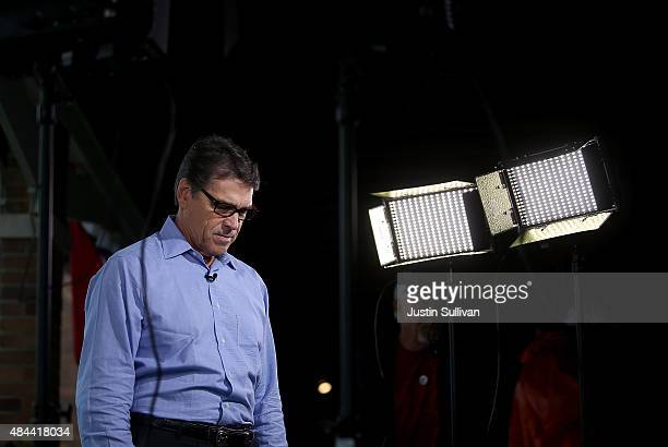 Republican presidential candidate and former Texas Gov Rick Perry pauses after conducting a television news interview at the Iowa State Fair on...