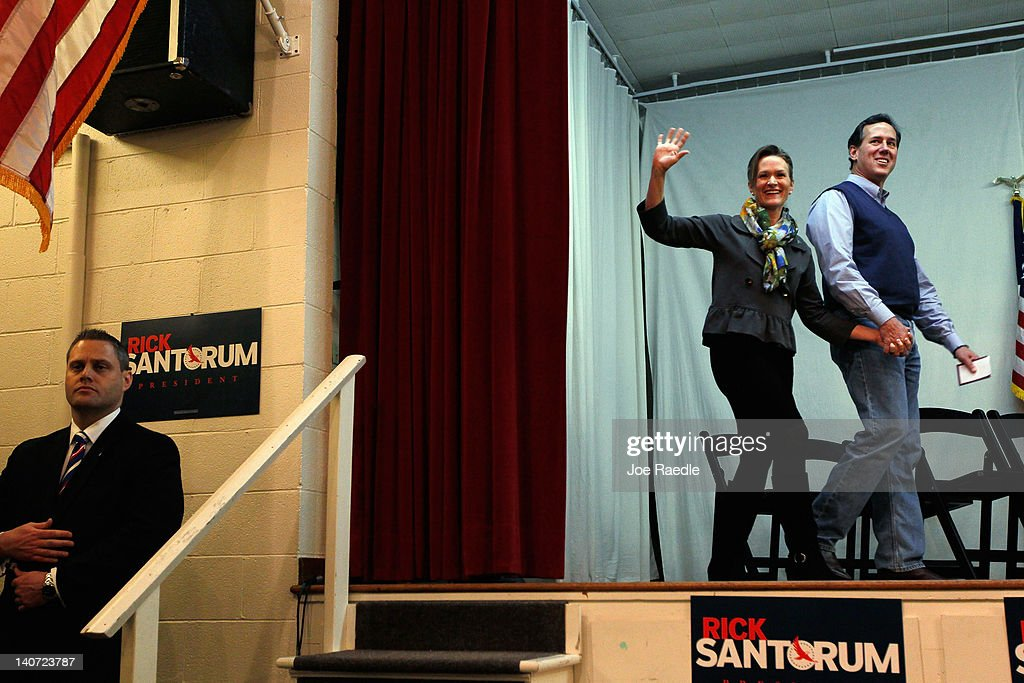 Republican presidential candidate and former US Sen Rick Santorum and his wife Karen Santorum arrive together for a campaign rally at an American...