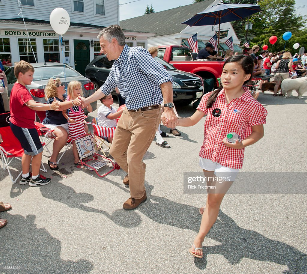 Republican Presidential candidate and former Utah Governor Jon Huntsman marching in the Amherst New Hampshire July 4th Independence Day parade with...