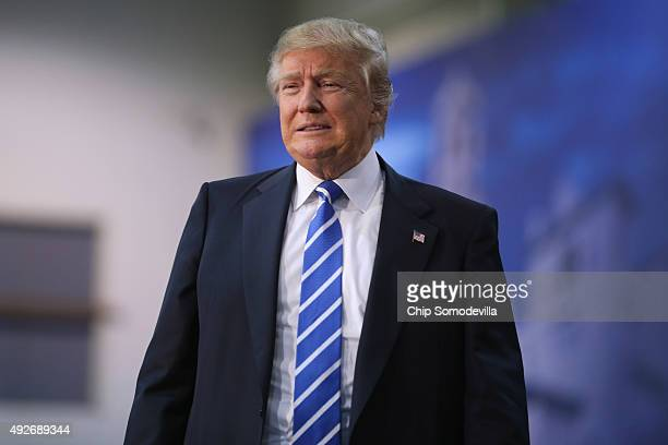 Republican presidential candidate and frontrunner Donald Trump arrives at a campaign rally at the Richmond International Raceway October 14 2015 in...
