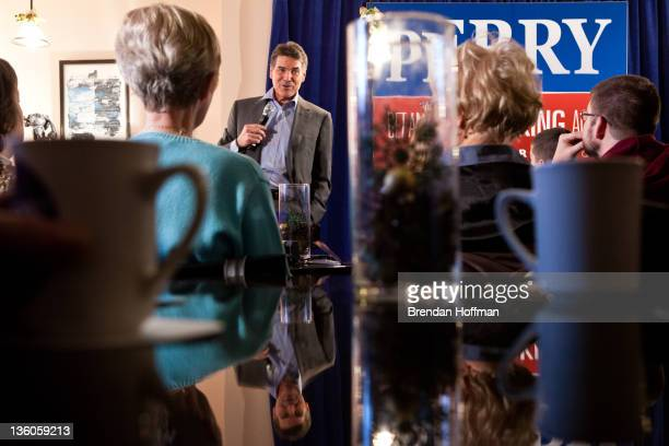 Republican presidential candidate and Texas governor Rick Perry speaks at a campaign meet and greet at De Brito Baking Bistro on December 21 2011 in...