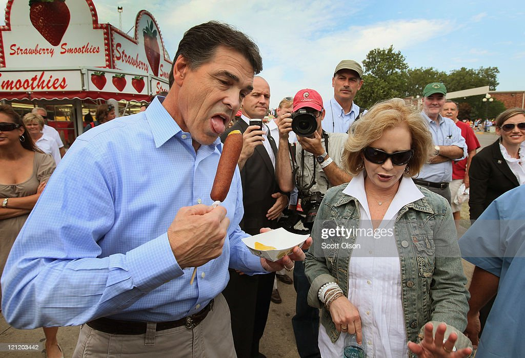 Republican presidential candidate and Texas Governor <a gi-track='captionPersonalityLinkClicked' href=/galleries/search?phrase=Rick+Perry+-+Politician&family=editorial&specificpeople=175872 ng-click='$event.stopPropagation()'>Rick Perry</a> tries a vegetarian corndog as he walks with his wife Anita at the Iowa State Fair August 15, 2011 in Des Moines, Iowa. Perry did not realize the treat was vegetarian until after he started eating. The visit is part of Perry's first campaign trip to Iowa since declaring he would seek the Republican nomination for president on August 13.