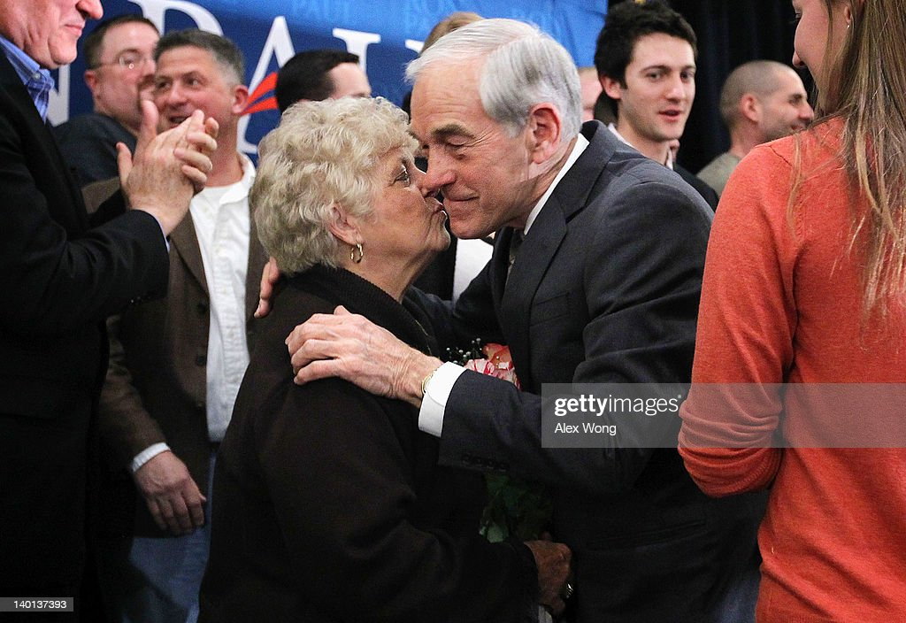 Republican Presidential candidate and U.S. Rep. <a gi-track='captionPersonalityLinkClicked' href=/galleries/search?phrase=Ron+Paul&family=editorial&specificpeople=2300665 ng-click='$event.stopPropagation()'>Ron Paul</a> (R-TX) (R) embraces his wife Carol (L) during a primary night party February 28, 2012 in Springfield, Virginia. According to early exit polls, Mitt Romney has a very slim lead over Rick Santorum in Michigan's primary, with Romney projected to win the Arizona primary. Voters in Michigan and Arizona went to the polls today to pick their choice for the Republican presidential nominee.