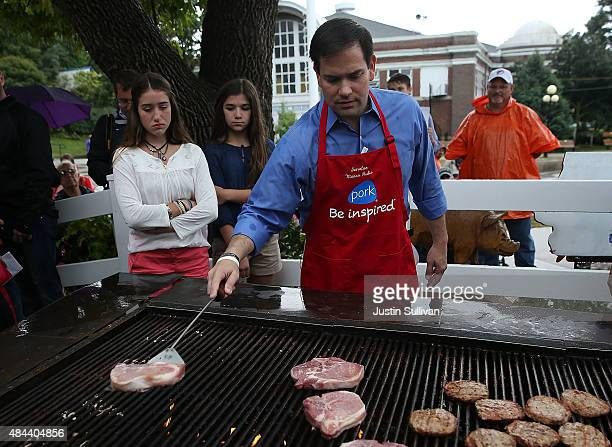 Republican presidential candidate and US Sen Marco Rubio mans the grill with at the Iowa Pork Producers Pork Tent during the Iowa State Fair on...
