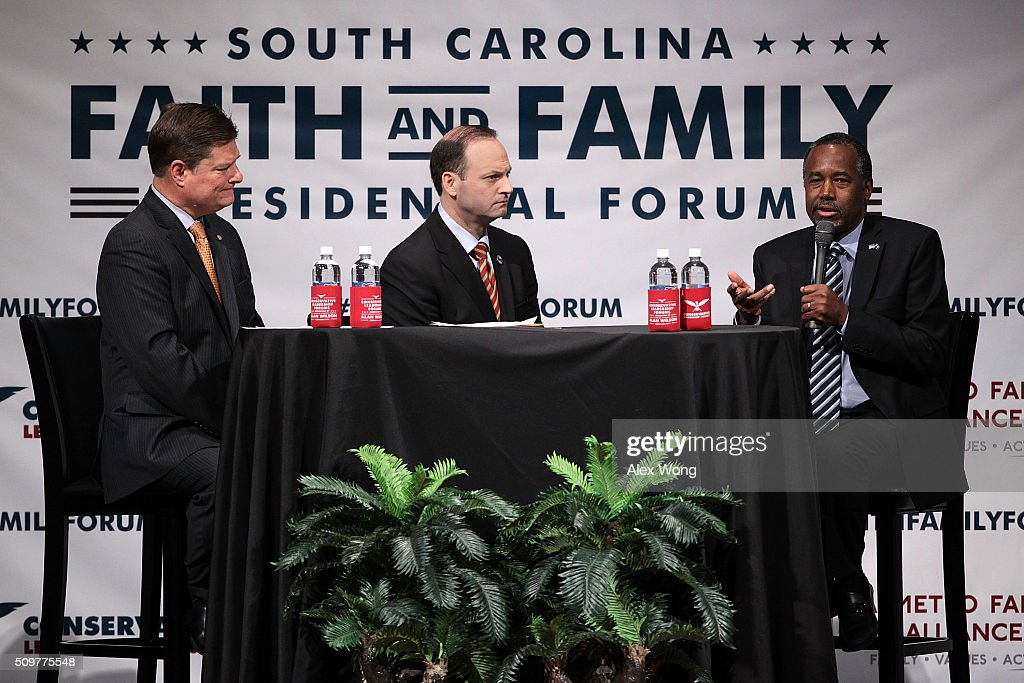 Republican presidential candidate <a gi-track='captionPersonalityLinkClicked' href=/galleries/search?phrase=Ben+Carson&family=editorial&specificpeople=3233819 ng-click='$event.stopPropagation()'>Ben Carson</a> (R) participates in the South Carolina Faith and Family Presidential Forum as moderators, South Carolina Attorney General Alan Wilson (2nd L) and Oran Smith (L), listen February 12, 2016 in Greenville, South Carolina. Four Republican candidates joined the forum as they continued to campaign in the Palmetto State.