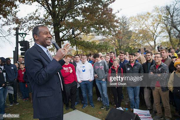 Republican presidential candidate Ben Carson speaks outside the Alpha Gamma Rho house during a campaign stop at Iowa State University on October 24...