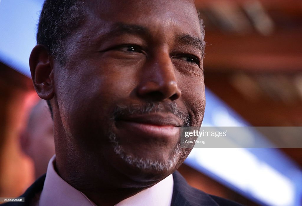 Republican presidential candidate Ben Carson speaks to members of the media in the spin room prior to a CBS News GOP Debate February 13, 2016 at the Peace Center in Greenville, South Carolina. Residents of South Carolina will vote for the Republican candidate at the primary on February 20.