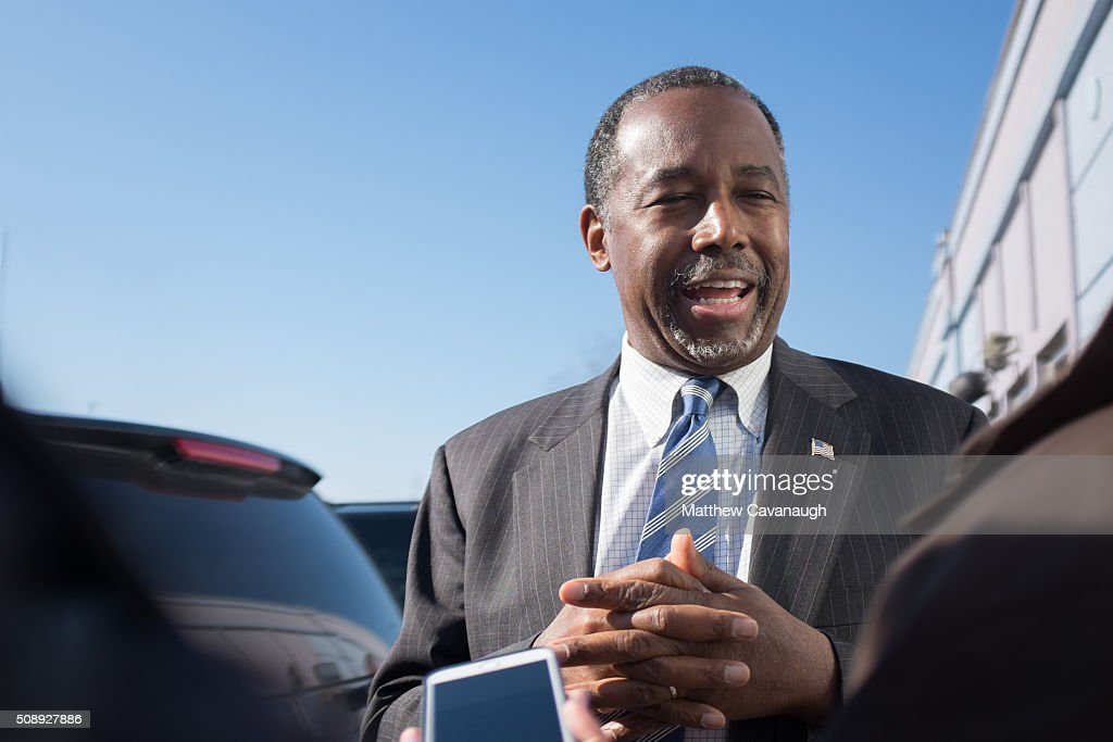 Republican presidential candidate <a gi-track='captionPersonalityLinkClicked' href=/galleries/search?phrase=Ben+Carson&family=editorial&specificpeople=3233819 ng-click='$event.stopPropagation()'>Ben Carson</a> speaks to reporters after stopping at The Airport Diner on February 7, 2016 in Manchester, New Hampshire. Carson is campaigning in the lead up to the The New Hampshire primary, February 9.