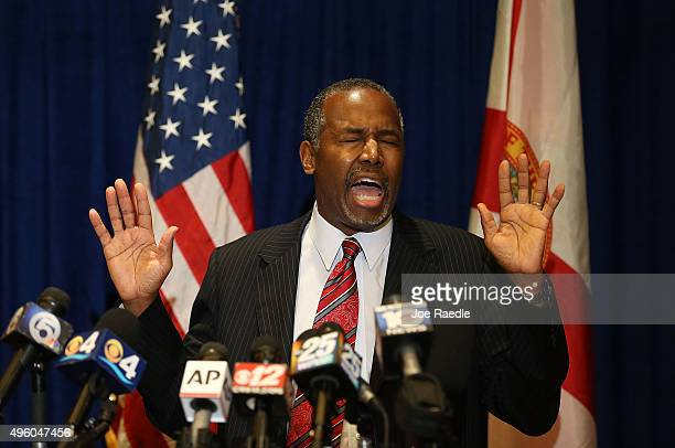 Republican presidential candidate Ben Carson speaks to the media before speaking at a gala for the Black Republican Caucus of South Florida at PGA...