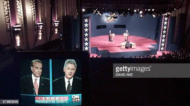 Republican presidential candidate Bob Dole and US President Bill Clinton are shown on a television monitor during the first of two televised debates...