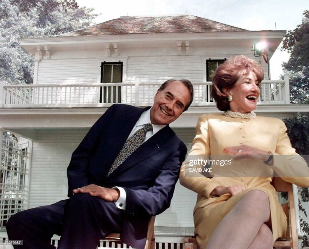 US Republican presidential candidate <a gi-track='captionPersonalityLinkClicked' href=/galleries/search?phrase=Bob+Dole&family=editorial&specificpeople=118596 ng-click='$event.stopPropagation()'>Bob Dole</a>(L)and his wife Elizabeth(R) look for people in the audience they recognize during a campaign stop at former US President Dwight Eisenhower's boyhood home (background) in Abilene, Kansas 09 August. Dole will travel to his home in Russell, Kansas later to announce his selection for a vice-presidential running mate 10 August.