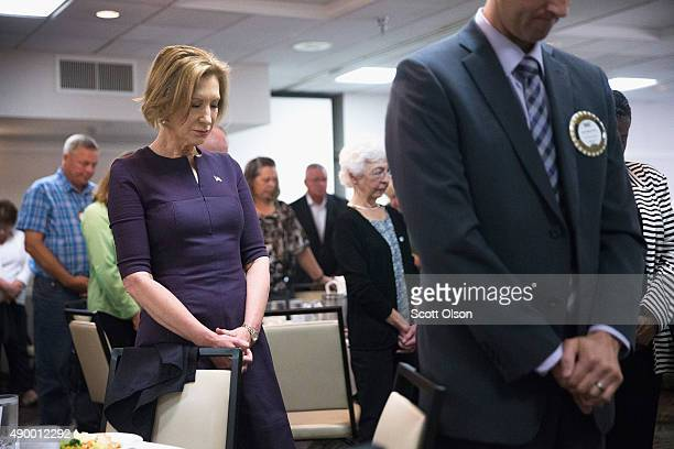 Republican presidential candidate Carly Fiorina listens a prayer before addressing the North Scott Rotary Club on September 25 2015 in Davenport Iowa...