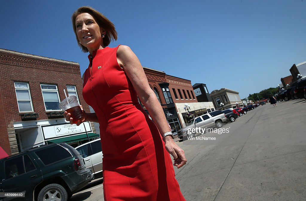 Republican presidential candidate Carly Fiorina walks down Main Street after having lunch at the Starboard Market August 14, 2015 in Clear Lake, Iowa. Fiorina greeted patrons at the restaurant before continuing to campaign in Iowa later in the afternoon.