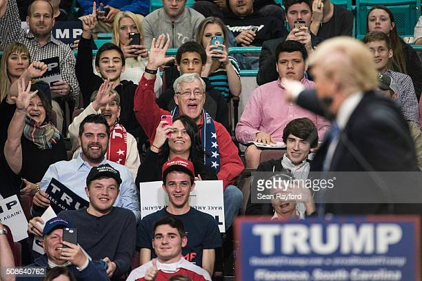 Republican presidential candidate Donald Trump acknowledges supporters at a campaign rally February 5 2016 in Florence South Carolina Trump's...