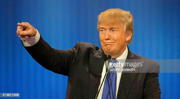 Republican Presidential candidate Donald Trump acknowledges his supporters during the Republican Presidential Debate in Detroit Michigan March 3 2016...