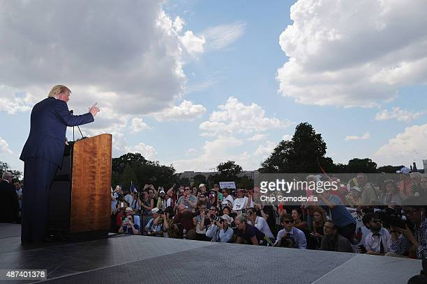Republican presidential candidate Donald Trump addresses a rally against the Iran nuclear deal on the West Lawn of the US Capitol September 9 2015 in...
