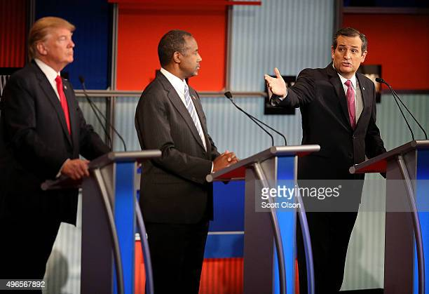 Republican presidential candidate Donald Trump and Ben Carson looks on as US Sen Ted Cruz speaks during the Republican Presidential Debate sponsored...