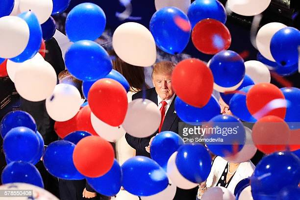 Republican presidential candidate Donald Trump and his family acknowledge the crowd as balloons fall on the fourth day of the Republican National...