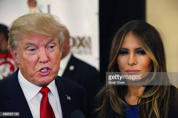 Republican presidential candidate Donald Trump and his Melania speak with members of the media in the spin room after the Republican Presidential...