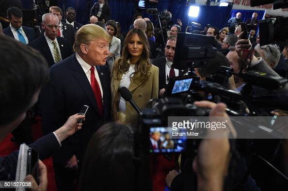 Republican presidential candidate Donald Trump and his wife Melania Trump talk to reporters in the spin room following the CNN presidential debate at...